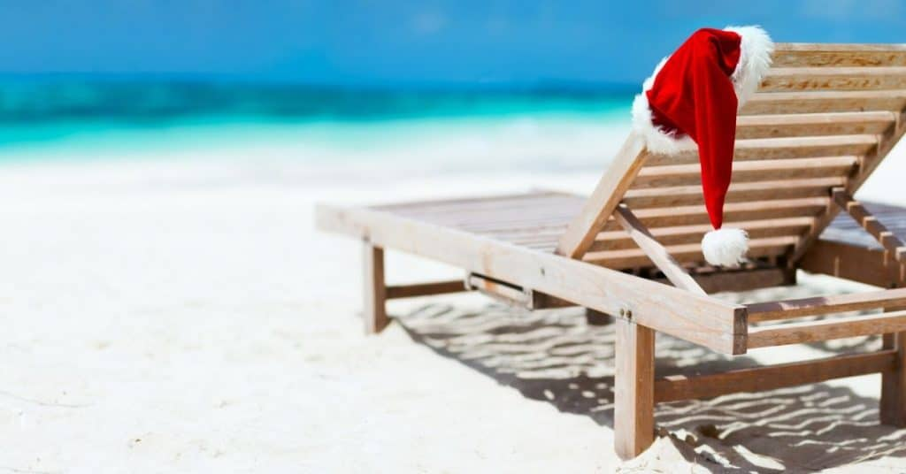 Beach with Santa's Hat on Deck Chair - Christmas in July