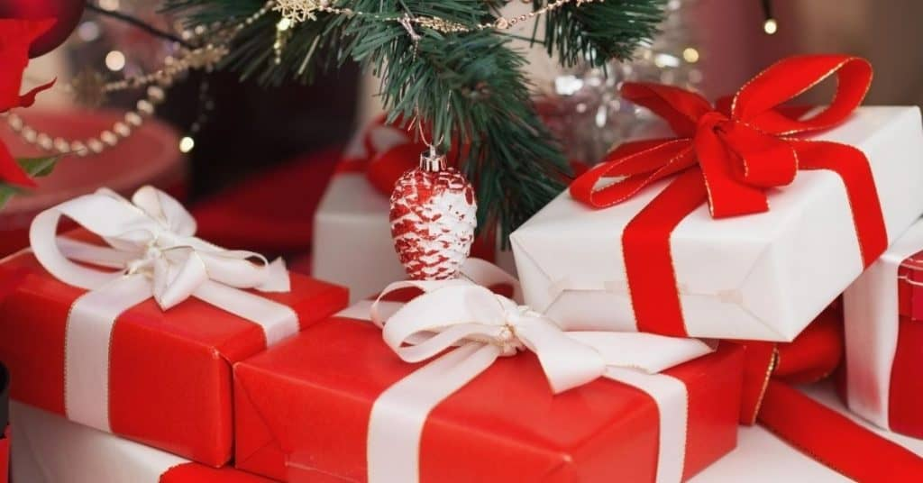 Box Shaped Presents Under the Christmas Tree on Christmas Eve - Open for Christmas