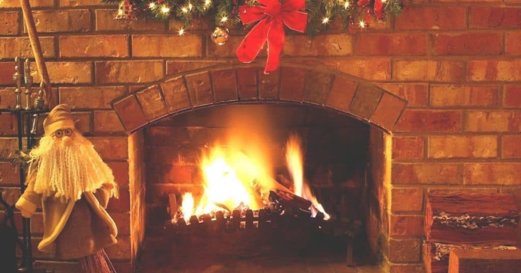 Burning wood in a fireplace - Christmas Traditions and Customs - What is a Yule Log - Open for Christmas