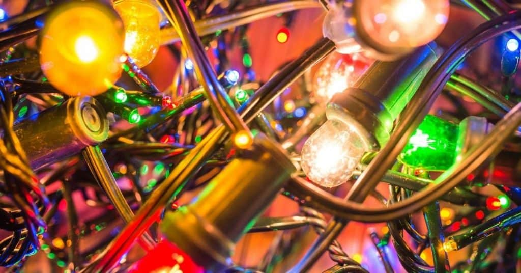 Close up photo of LED multicoloured Christmas lights - Open for Christmas