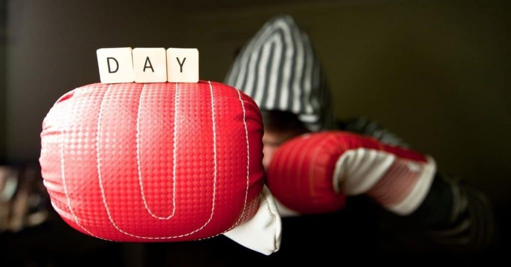 Day Scrabble Letters Balanced on Man Wearing Boxing Gloves - Open for Christmas