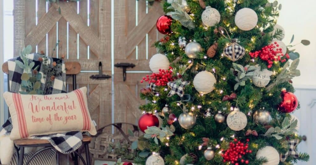 Farmhouse Christmas Decorations with Christmas Tree and Chair Next To It- Open for Christmas