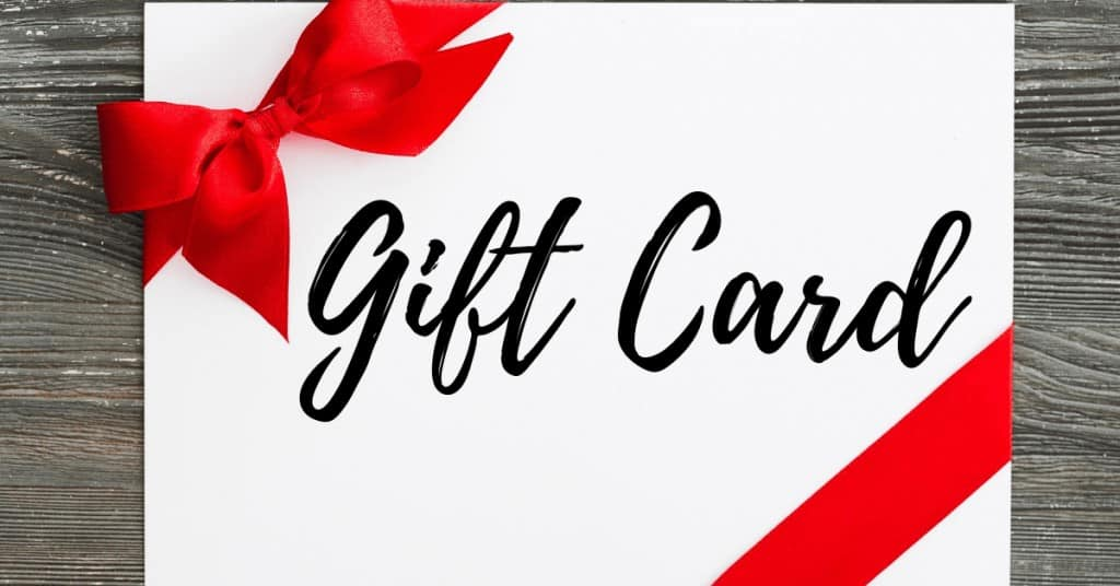 Gift Card Written on White Card with Red Bow - Best Christmas gifts for couples