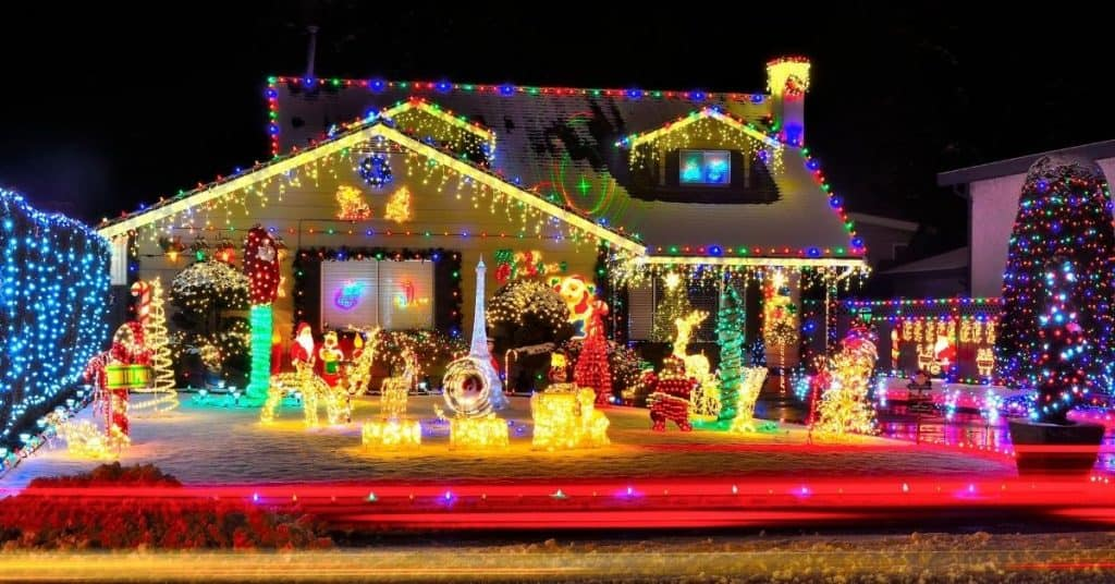 Outdoor LED warm Christmas lights on a house - Open for Christmas