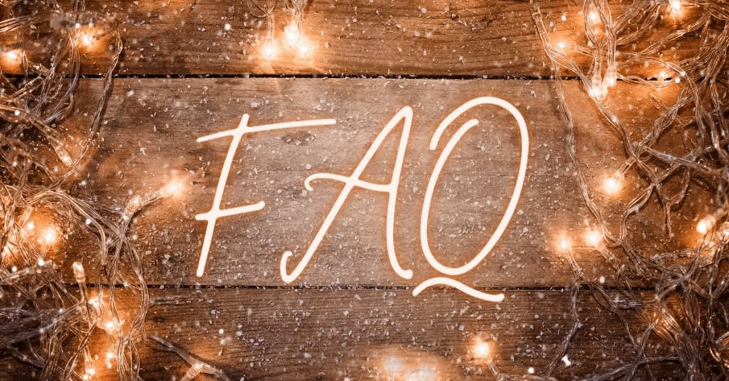 The Word FAQ on a wooden background with LED Lights Around - Open for Christmas