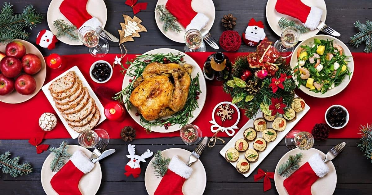 Turkey on Table with apples, salad, sides decorated in seasonal festive decor