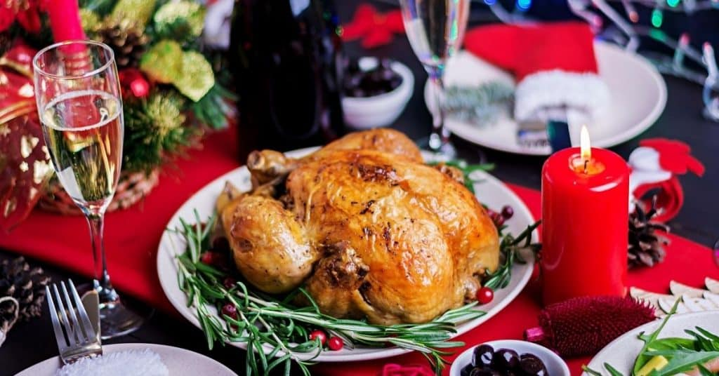 Turkey on Table with wine and candle decorated in seasonal festive decor