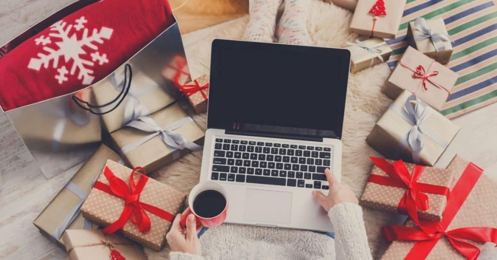 A woman doing her Christmas shopping online - tips on how to shop this holiday - Open for Christmas