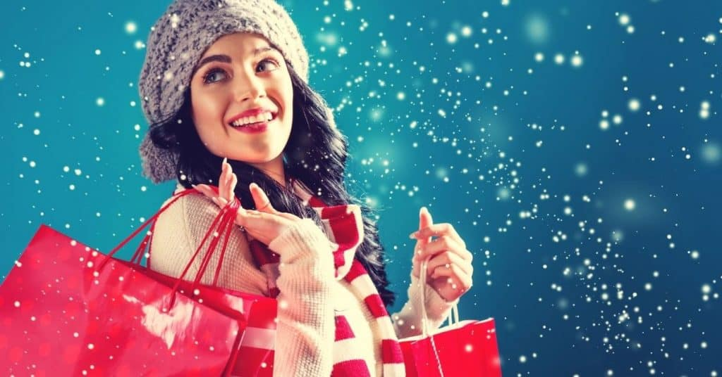 A woman doing her Christmas shopping - tips on how to shop this holiday - Open for Christmas