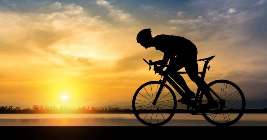 Man on a Bike in the sunset - Best Cycling Gifts for Him UK - Open for Christmas