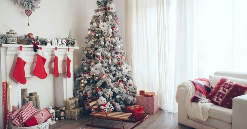 Red and White Decorated Tree in a Living Room - Open for Christmas