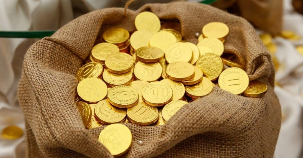 Sack full of gold coins - Who is Kris Kringle - Open for Christmas