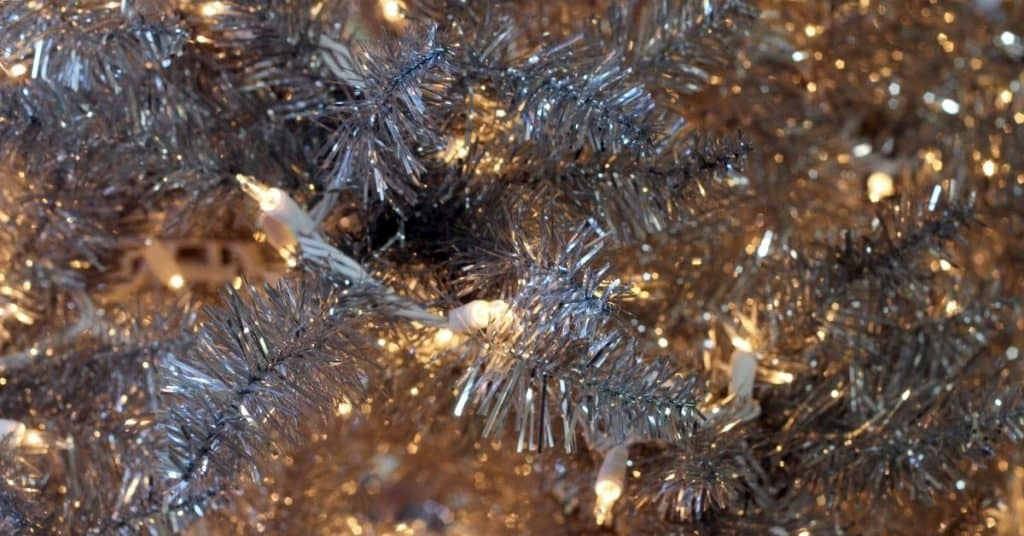 Silver Tinsel on a Christmas Tree - Open for Christmas