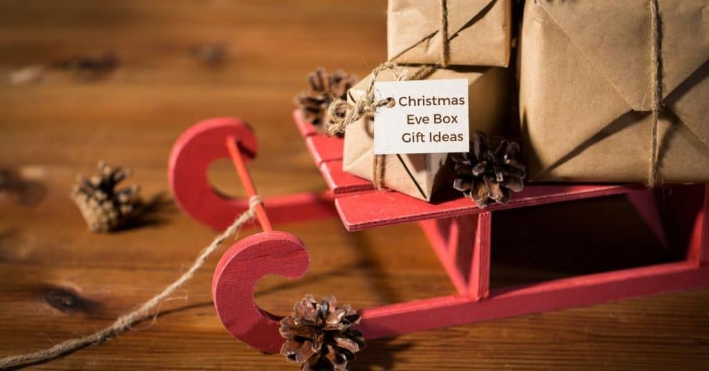 The Best Christmas Eve Box Gift Ideas for Adults Wrapped Up on a Festive Sleigh with Decorations - Open for Christmas