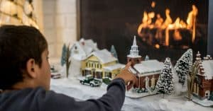 Young Boy Looking at the Best Christmas Village Set - Open for Christmas
